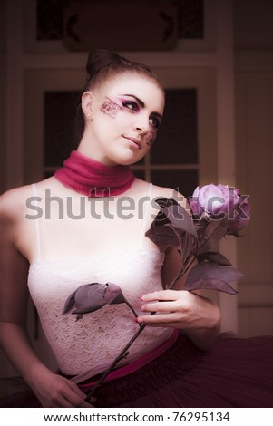 Cute Dancer Woman Wearing Dance Tutu Or Leotard Holds A Flower By Her Front Door While Dancing And Swaying In A Dreamy Romance Affair - stock photo
