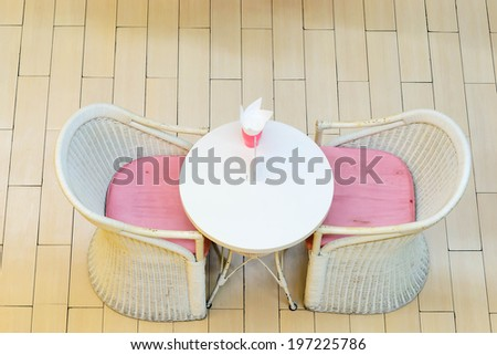 cute dinning table set made from rattan - stock photo