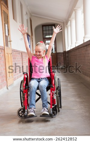 Cute disabled pupil in hall at the elementary school - stock photo