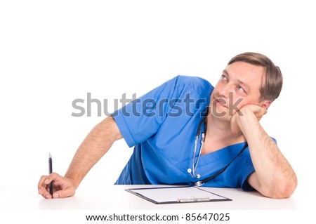 cute doctor in blue posing at table