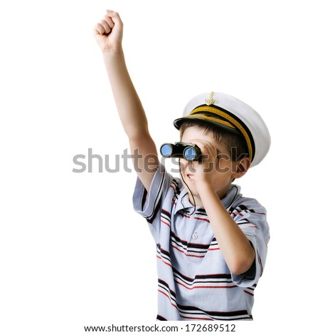 Cute dreaming boy in captain cap looking through a binocular. isolated over white background. - stock photo