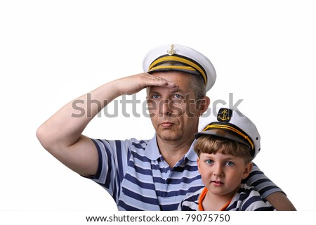 Cute dreaming child with his father. both in captain cap. isolated over white background. - stock photo