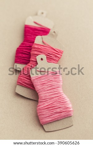 Cute dress form embroidery thread holders - stock photo