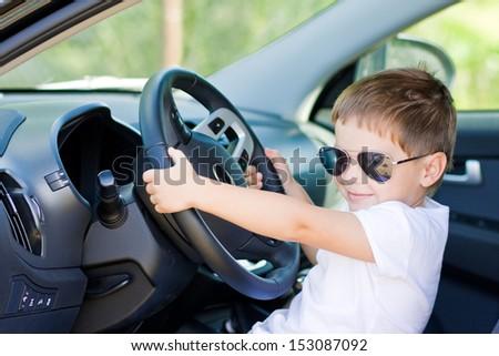 Cute driver in car - stock photo