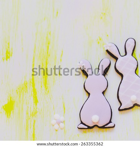 Cute Easter bunny cookies decorated with royal icing. Selective focus on bunny tails. - stock photo