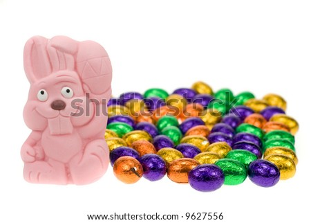 cute easter bunny surrounded by easter eggs isolated on a white background - stock photo