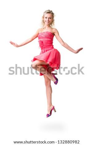 Cute elegant woman in little dress jumping,  full length studio portrait isolated on white - stock photo