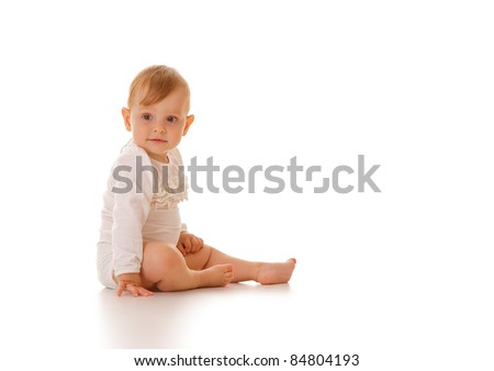 Cute eleven months old caucasian baby girl isolated.