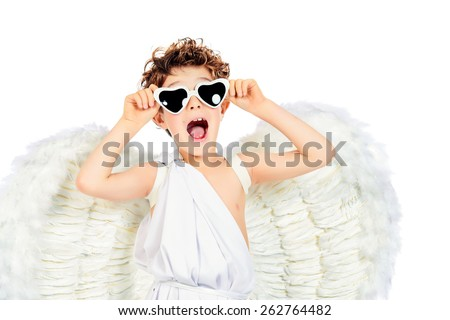 Cute emotional little boy in a costume of angel. Cupid. Valentine's day. Isolated over white. - stock photo