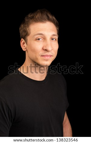 Cute European adult male in black shirt - stock photo