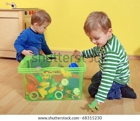 Cute european toddlers in kindergarten. - stock photo