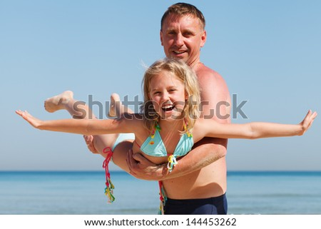 Cute Family - Father and Daughter on Vacation - stock photo