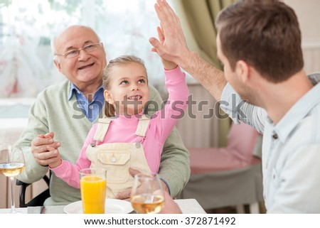 Cute family has a dinner in cafe - stock photo