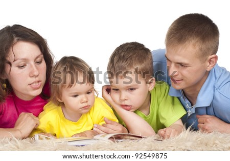 cute family of a four  lying on carpet