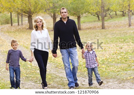Cute Family on a walk together - stock photo