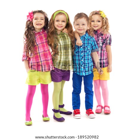 Cute fashion kids are standing together, on the white background . Fashionable and friendship concept