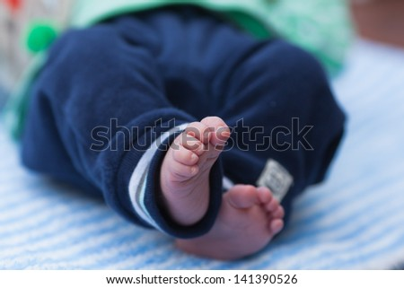 cute feet of a baby lying on the blanket
