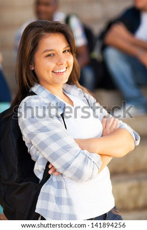 cute female highschool student with arms crossed - stock photo