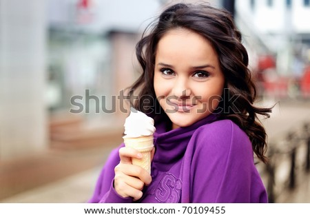 Cute female holding an icecream - stock photo