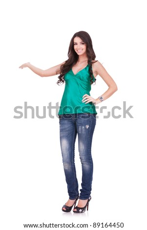 Cute female student presenting and showing copy space for product of text - stock photo
