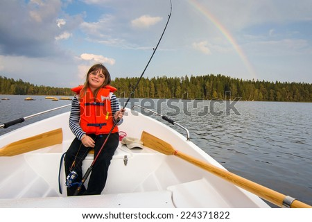 Cute fishing girl in beautiful scenery