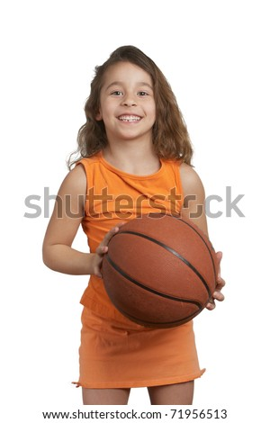 Cute five year old girl holding basketball - stock photo