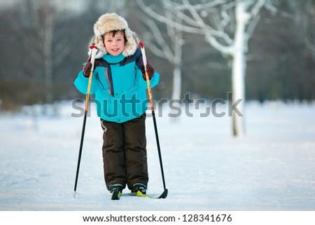Cute five years old boy skiing on cross - stock photo