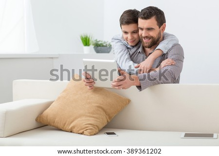 Cute friendly family are playing modern toys - stock photo