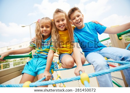 Cute friends having fun on playground - stock photo