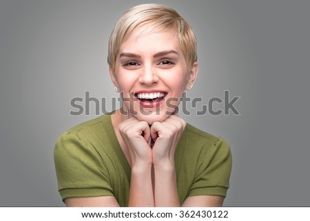 Cute fun bubbly adorable personality modern young fresh pixie haircut perfect teeth smile - stock photo