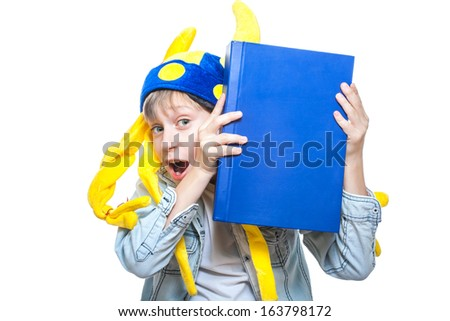 Cute funny angry child pretending to be a barbarian holding a very big blue book looking enraged (isolated on white background) - stock photo