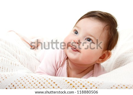 cute funny infant baby looking up in left corner smiling and show tongue, beautiful kid's face closeup with copyspace over white - stock photo