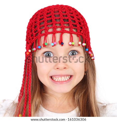 cute funny little girl in the holiday knitted cap - stock photo
