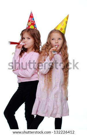 Cute funny little girls at the party on white background on Holiday