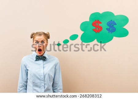 Cute geek girl is in panic because she has got money problems.Money problems - stock photo
