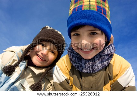 Cute girl and boy winter portrait - stock photo