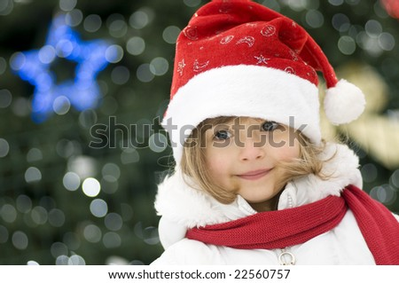 Cute girl and Christmas Tree - stock photo