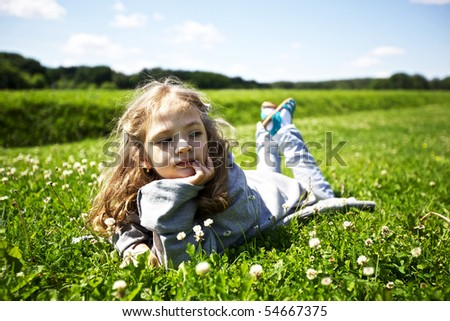 cute girl at a green field background