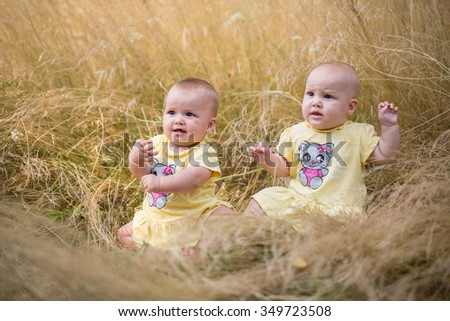 Cute Girl Baby Twins Seating Golden Stock Photo (Royalty Free ...