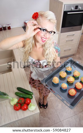 Cute girl baking muffins, similar available in my portfolio - stock photo