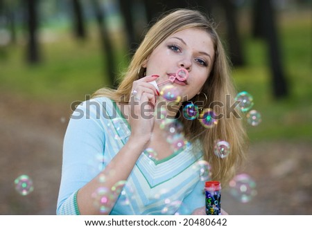 cute girl blowing bubbles