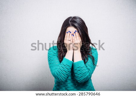 cute girl covers his face - stock photo