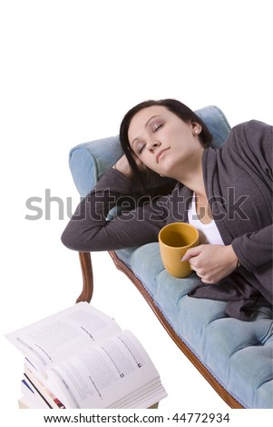 Cute Girl Fell Asleep after Studying on the Couch - stock photo