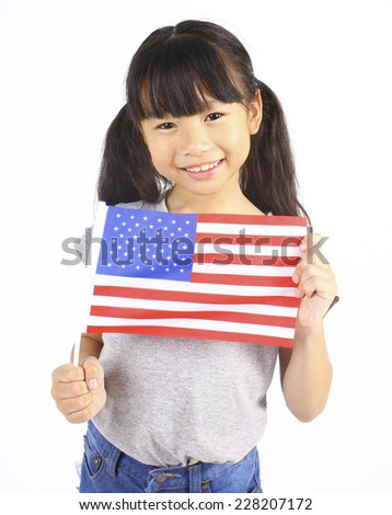 Cute girl holding an American Flag  - stock photo