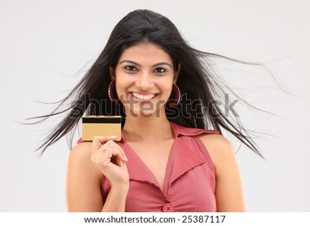 cute girl holding credit card - stock photo