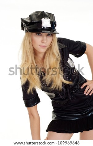 Cute girl in a uniform of  police officer on a white background