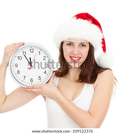 Cute girl in Christmas red santa hat with clock over a white background - stock photo