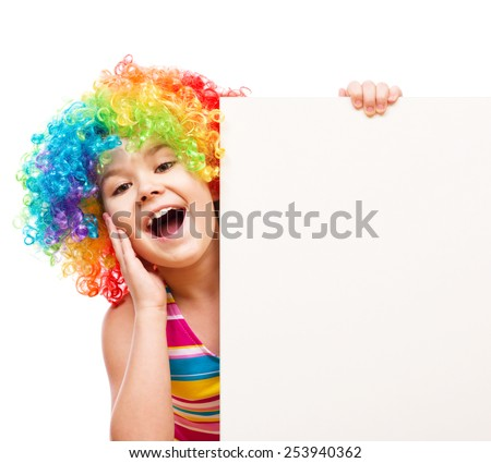Cute girl in clown wig is holding blank banner, isolated over white - stock photo