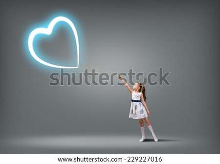 Cute girl in dress with heart shaped balloon on rope