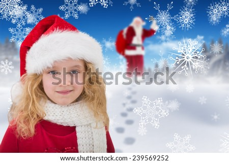 Cute girl in santa hat against bright blue sky over clouds - stock photo
